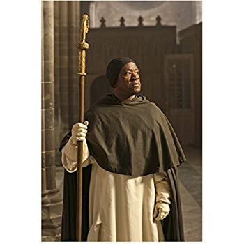 The Hollow Crown 8inch x 10inch Photo Lucian Msamati Wearing All Black & White Holding Staff Pose 1 kn
