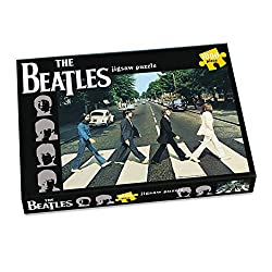 A fantastic 1000 piece puzzle featuring The Beatles album cover Abbey Road A must have puzzle for all Beatle fans. Finished piece measures 590mm x 685mm Presented in a shrink wrapped high quality cardboard box Suitable for 12 years and over