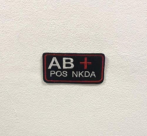 Parche bordado para planchar o coser con la marca AB Positive NKDA