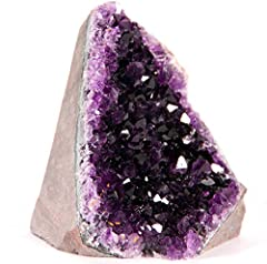"""TWO BONUSES: Each cluster includes a beautiful 3 inch Selenite Wand in a velvet bag and our booklet """"Caring for your Amethyst."""" SPECIFICATIONS: This beautiful geode weighs 0.5 to 1.0 lbs with a Basalt (volcanic rock) backing. The base is cut so it wi..."""