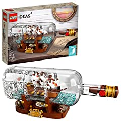 Build a ship in a bottle featuring a brick-built cork and wax seal, ship with a captain's quarters, cannons, mast, crow's nest, sails, flag, display stand with a nameplate and 'compass'! This LEGO Ideas ship in a bottle model kit comes with an instru...