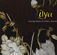 Carving Heads on Cherry Stones by Ilya (2013-05-03)