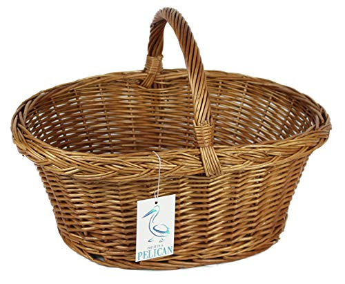 Shopping baskets in natural double steamed willow. Wicker picnic baskets. Vegetables, bread, cutlery and bottles (Oval natural)
