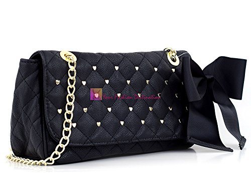 "Overtop Flap With a Snap Closure, Inside Zipper, 2 Inside Slots, Measures 12.5""x6""x4"", Partially Chain Shoulder Strap Betsey Johnson Emblem on Back, Accented With A Large Black Bow on Right Side"