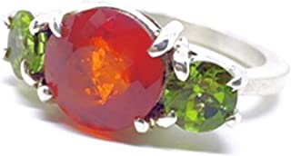 Imponente anello con magnifico e brillante Granato Spersatite di diametro 9,4 mm e 4,75 carati, accompagnato da due magnif...