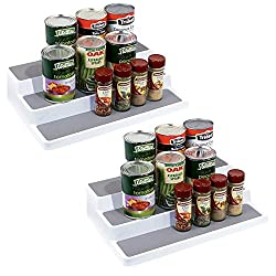 2 white and grey plastic stepped shelf risers