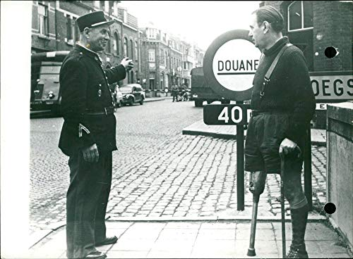 French customs officer indicating the route to Georges Paillot - Vintage Press Photo