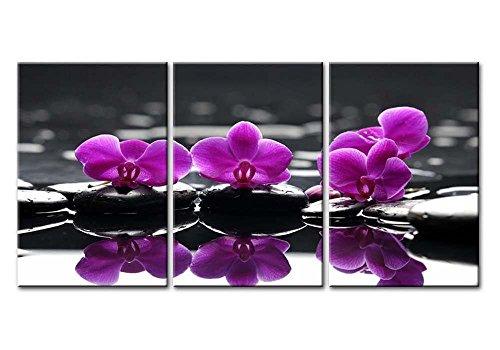 Tableau triptyque impression giclée sur toile, représentant des orchidées papillons en fleur sur des galets gris zen.