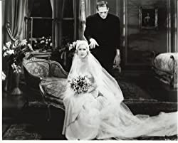 Frankenstein's monster (Boris Karloff) menacingly approaches Frankenstein's bride on their wedding night in Bride of Frankenstein