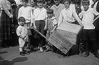 Toddler Holds a Small Soap Box Derby Vehicle with an add for Kirkmans Borax to The Delight of a Slew of Young Friends who ...
