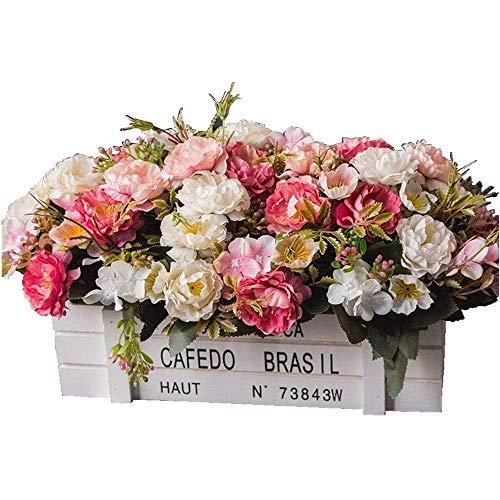 Original centro con caja blanca de madera y flores rosáceas