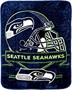 """Features NFL team helmet above team name and logo Soft and warm raschel fabric; oversized; decorative binding around all edges Measures 60""""W x 80""""L Machine wash cold separately using delicate cycle and mild detergent. Do not bleach. Machine dry separ..."""