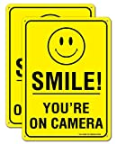 Smile You're on Camera Video Surveillance Sign  - 2 Pack - 10 x 7 Inches Rust Free .040 Aluminum - Reflective - UV Protected, Waterproof, Weatherproof and Fade Resistant - 4 Pre-drilled Holes