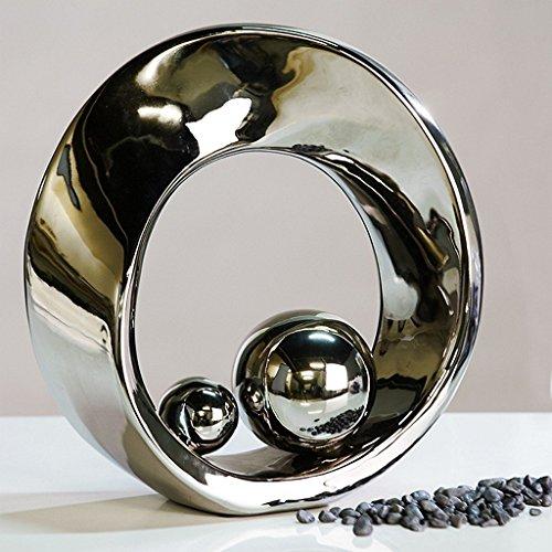 Hermosa escultura SPIN plata de ceramica con 2 bolas de color plata, altura 21 cm