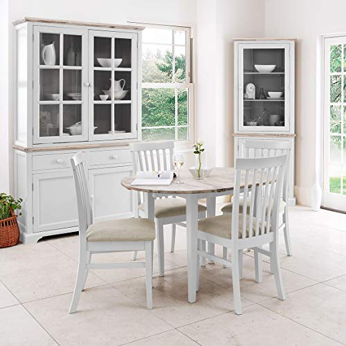 Florence white extending table and 4 upholstered dining chairs. Quality table and chair set with hidden center extension leaf.