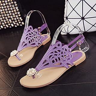 Las damas cool zapatillas en verano toe de fondo plano.