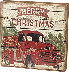 Farmhouse Christmas Decor sign with a red truck and Christmas trees.