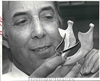 Historic Images 1980 Press Photo Houston dentist Dr. George Robbins with dental implant - 8 x 10 in