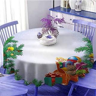 Nappe ronde pour le Nouvel An, jouets pour enfants, composition à l'intérieur d'un sac de Père Noël, ours en peluche, boît...