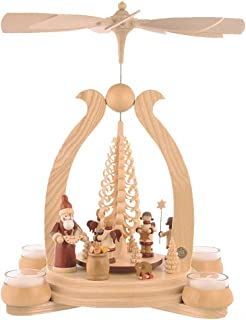 Müller German christmas pyramid arch Santa giving out X-mas presents, 1-tier, height 34 cm / 13 inch, natural with tealights, original Erzgebirge by Mueller Seiffen MU 10348