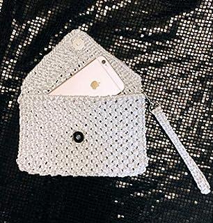 Borsa pochette in macramè argento lurex luminoso con maniglia (polsiera) e bottone magnetico