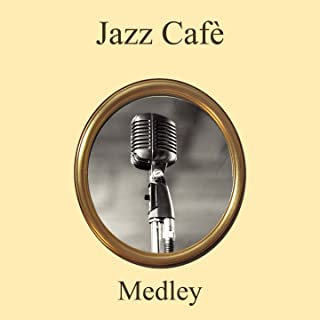 Jazz Café Medley: Put 'Em in a Box, Tie 'Em with a Ribbon / Blue Bird / Doug the Jitterbug / Georgia on My Mind / Bouncing with Bud / That Boy / Groovin' High / Nature Boy / Taking a Chance on Love / Milestones / Ole Buttermilk Sky / That Old Black Magi