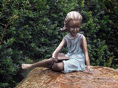 pompidu-living sitzendes und lesend Mädchen, Bronzefigur