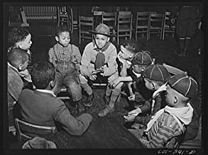 1942 Photo Chicago, Illinois. Ida B. Wells Housing Project. A meeting of the Cub Scouts in the community center Location: Chicago, Cook County, Illinois