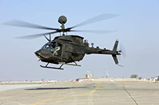 Posterazzi PSTTMO100181M an OH-58D Kiowa Warrior hovers Over The Flight line at Camp Speicher Iraq Poster Print, 17 x 11