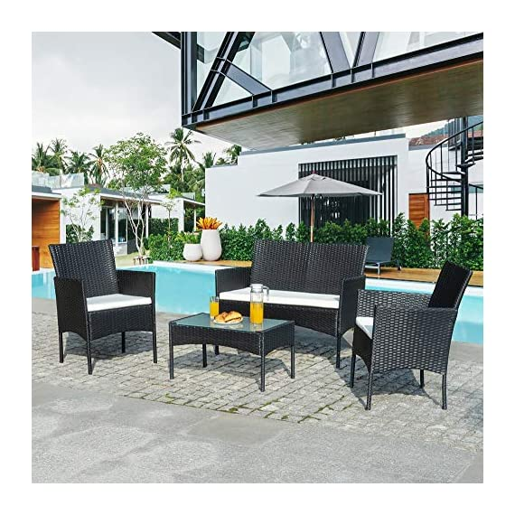Walsunny 4 Pieces Outdoor Patio Furniture Sets Rattan Chair Wicker Set,Outdoor Indoor Use Backyard Porch Garden Poolside Balcony Furniture(Black) 7 CHARMING CONVERSATION SET – Great for small spaces or creating a cozy nook, this outdoor wicker furniture set comes with two chairs, a love-seat, and a tempered glass top table. GORGEOUS GLASS TABLE TOP – Each perfectly-sized drink table features a tempered glass top that's equally gorgeous and durable for long-lasting outdoor use. WEATHER-RESISTANT RESIN – Designed specifically for indoor or outdoor use, this wicker conversation set is strong enough to withstand the rain, sun, and wind.