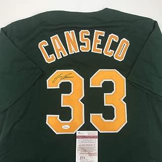 Autographed/Signed Jose Canseco Oakland Dark Green Baseball Jersey JSA COA