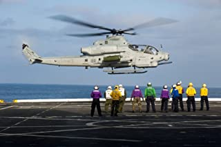 Posterazzi Sailors and Marines Watch an AH-1Z Viper Attack Helicopter Lift Off The Flight Deck of USS New Orleands Poster Print, (34 x 23)
