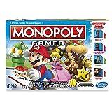 Monopoly Gamer : Jeu de société où le but du jeu est de gagner des points en ramassant des pièces, en achetant des propriétés et en vainquant des Boss.  Le joueur qui a le plus haut score gagne ! Version française. Principe du jeu : Deplacez-vous sur...