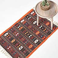 70 x 120 cm - 100% Cotton printed rug in kilim design. Suitable for kids room, conservatory or any other room. Spot clean only. Hand made in India using traditional handlooms with hand block printing makes this rug very eco friendly. Proceeds from th...