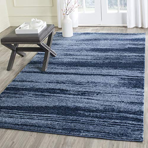 Blue area rug in living room