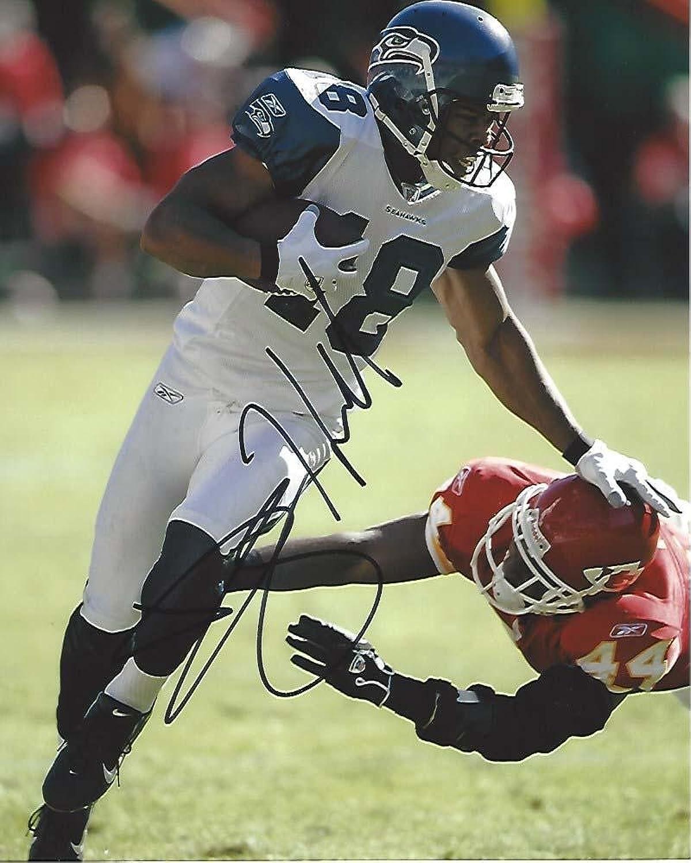 Autographed D.J. Hackett Photo  WR  18 8x10 color  Autographed NFL Photos