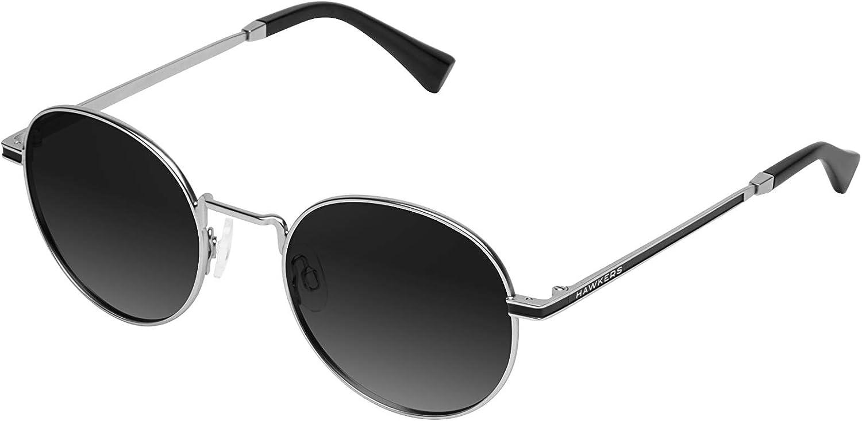 HAWKERS· Gafas de Sol MOMA para Hombre y Mujer.