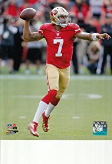 Colin Kaepernick San Francisco 49ers unsigned 8x10 photo (Red Jersey Throwing)
