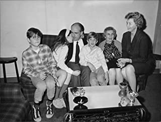 Vintage photo of Andreas G. Papandreou sitting with his family, in Paris.