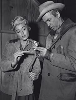 Film still featuring Elaine Stewart and James Stewart in Night Passage Photo Print (8 x 10)