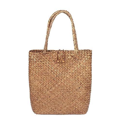 Las mujeres de playa del verano de asas de bolsas tejidas de paja Muchacha clásica del