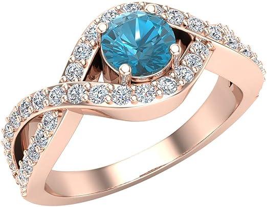 anillo de oro rosa con un diamante azul grande y entrelazado de diamantes blancos