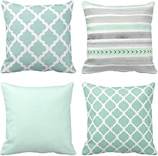 mint green and gold pillows