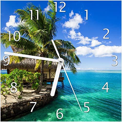 Wallario Glas-Uhr Echtglas Wanduhr Motivuhr; in Premium-Qualität; Größe: 20x20cm; Motiv: Karibisches Meer – Einsame Hütte unter Palmen