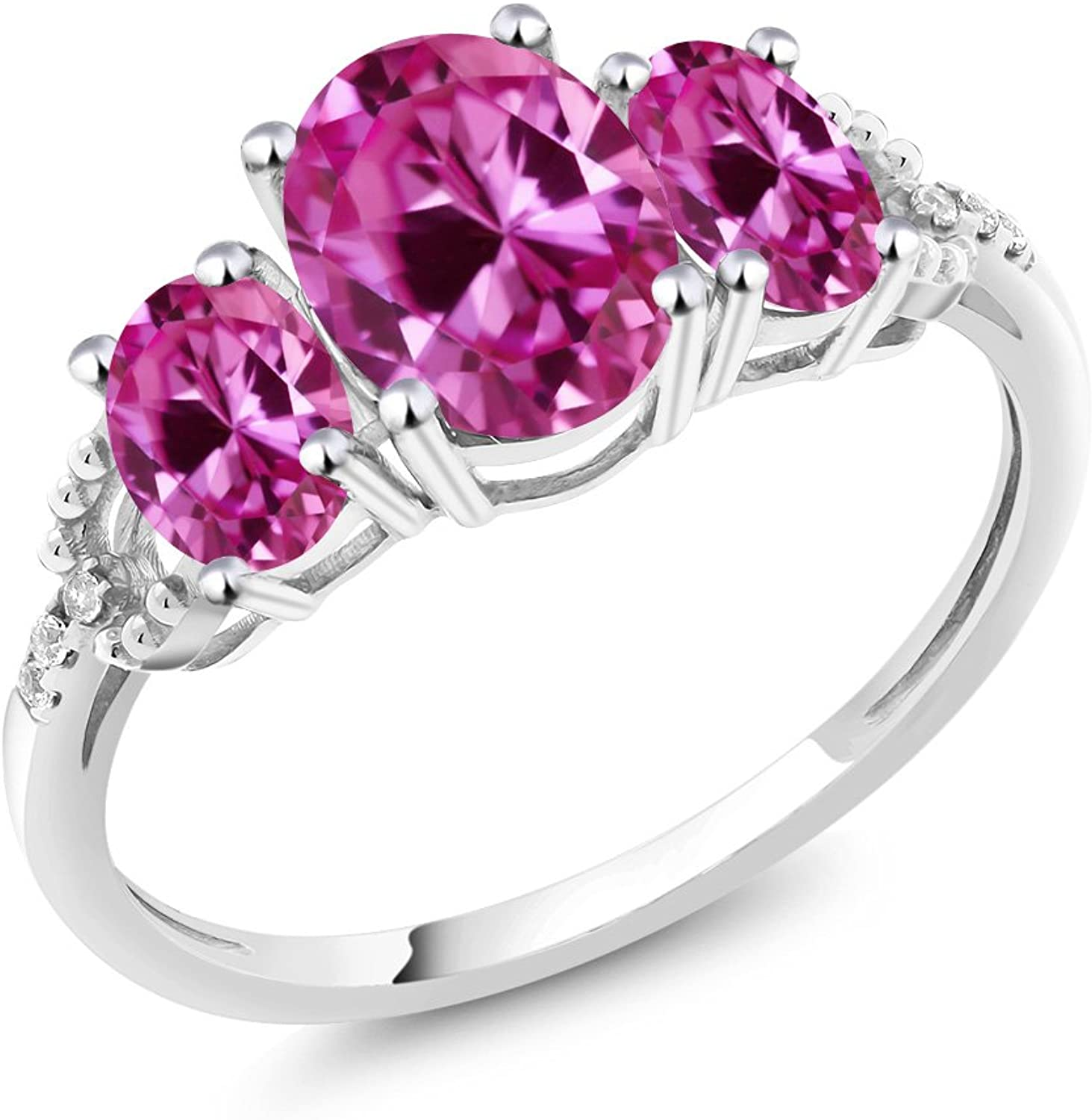 10K White gold Diamond Accent ThreeStone Engagement Ring set with 2.70 Ct Oval Pink Created Sapphire