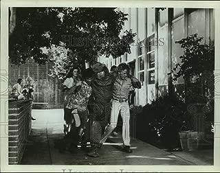 Historic Images - Press Photo Men Carry Man in Hazmat Suit