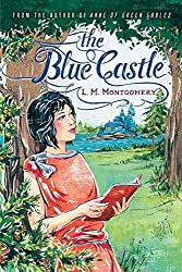 The Blue Castle by LM Montgomery; young woman in red dress leaning up against a tree reading a red book