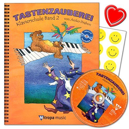 Tastenzauberei Band 2 - Klavierschule von Aniko Drabon. Schule für Einzel- und Gruppenunterricht in deutscher Sprache. CD zum Üben und Mitspielen, 7 lustige Smiley-Sticker, Notenklammer.