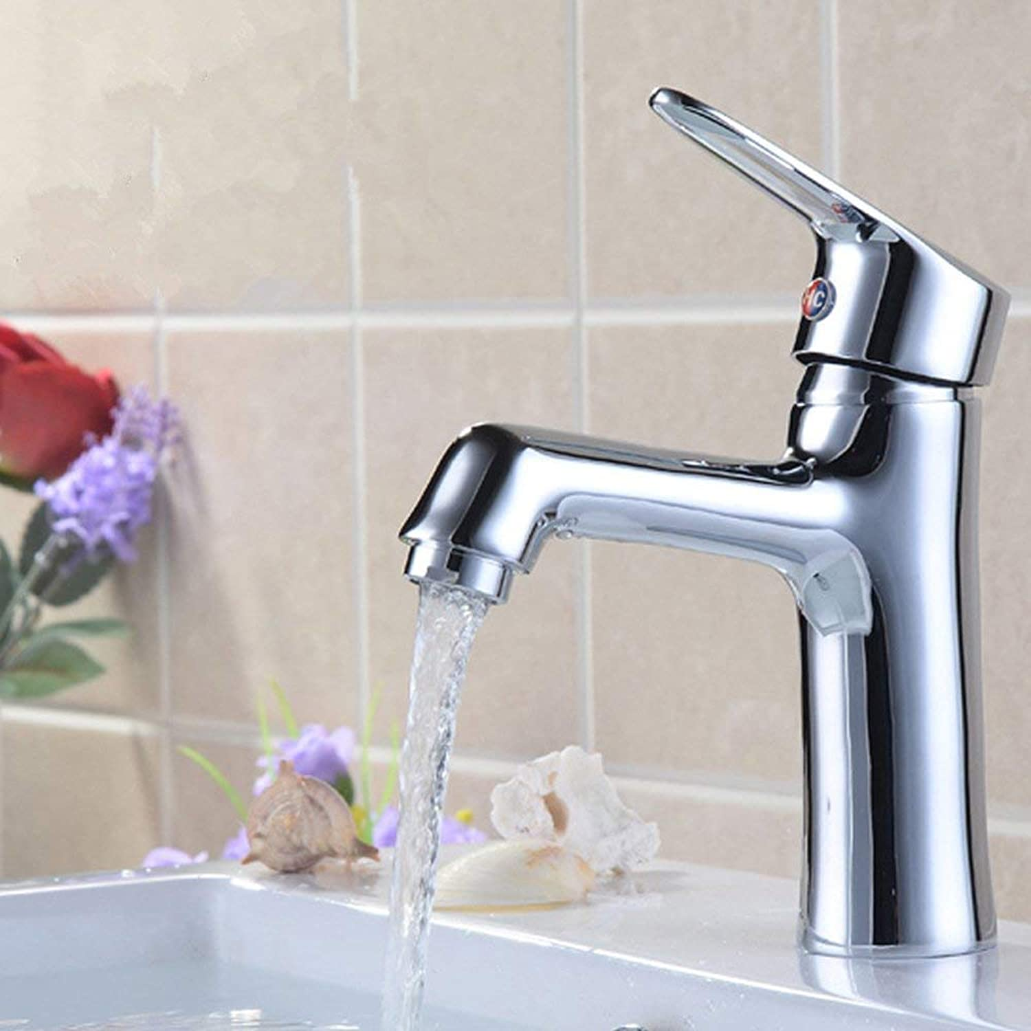 Mixing Valve of The hot and Cold Basin Faucet. Single Handle. Single Hole. Washing Your Bathroom. The Public tap Faucet