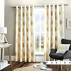 These eyelet curtains feature hand-drawn Scandinavian style yellow, grey and white leaves on a natural off-white background. Fully-lined with a light-filtering cream fabric, this design is perfect for modern contemporary minimalist homes. Fusion offe...
